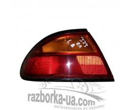 Фонарь задний левый Mazda 323 BA (1994-1998) фото