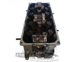 Головка блока цилиндров двигателя Hyundai Pony 1.5 i (1990-1995) фото